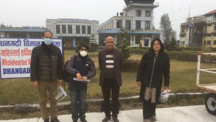 EATHEN project workers on field visit in front of a building