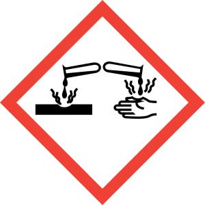 Varoituskyltti syövyttävästä aineesta